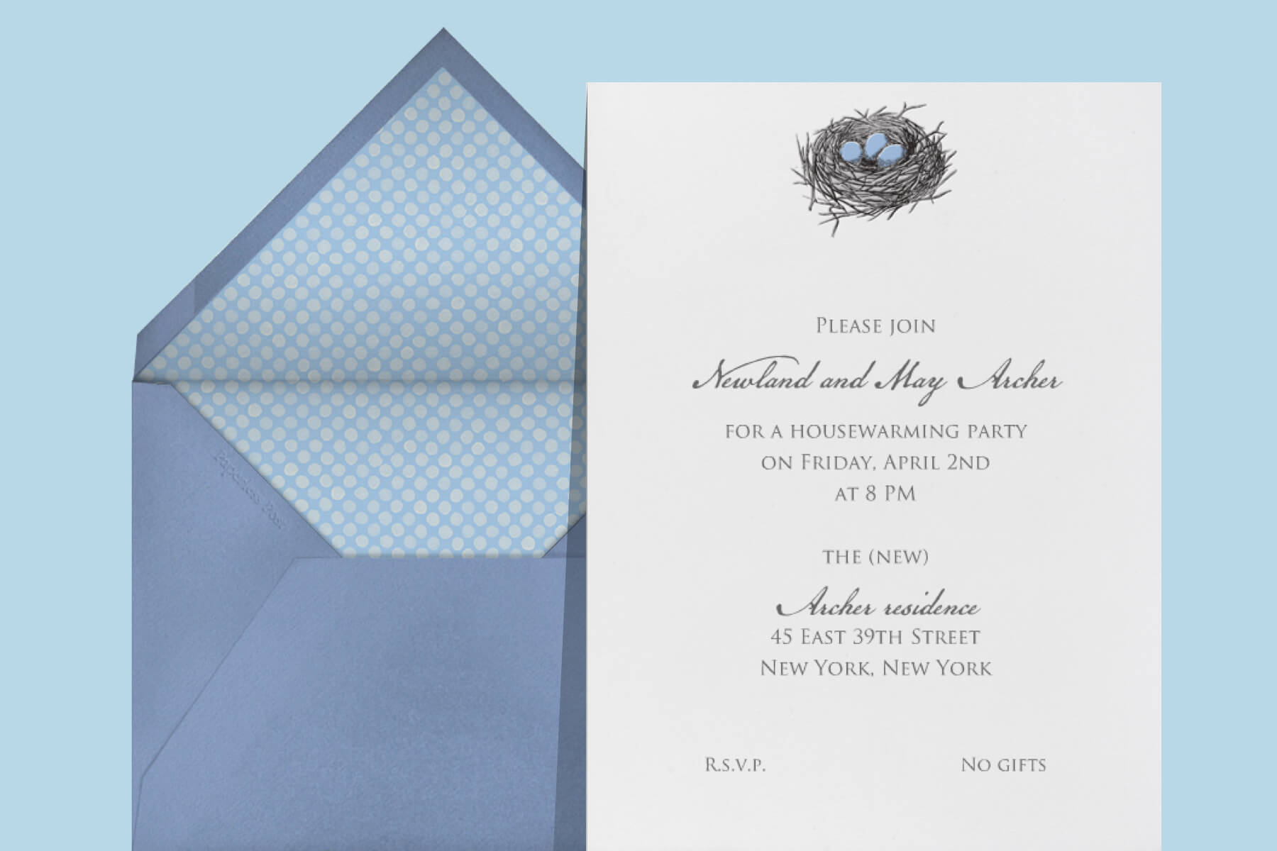An invitation with a small illustration of a bird's nest with blue eggs.