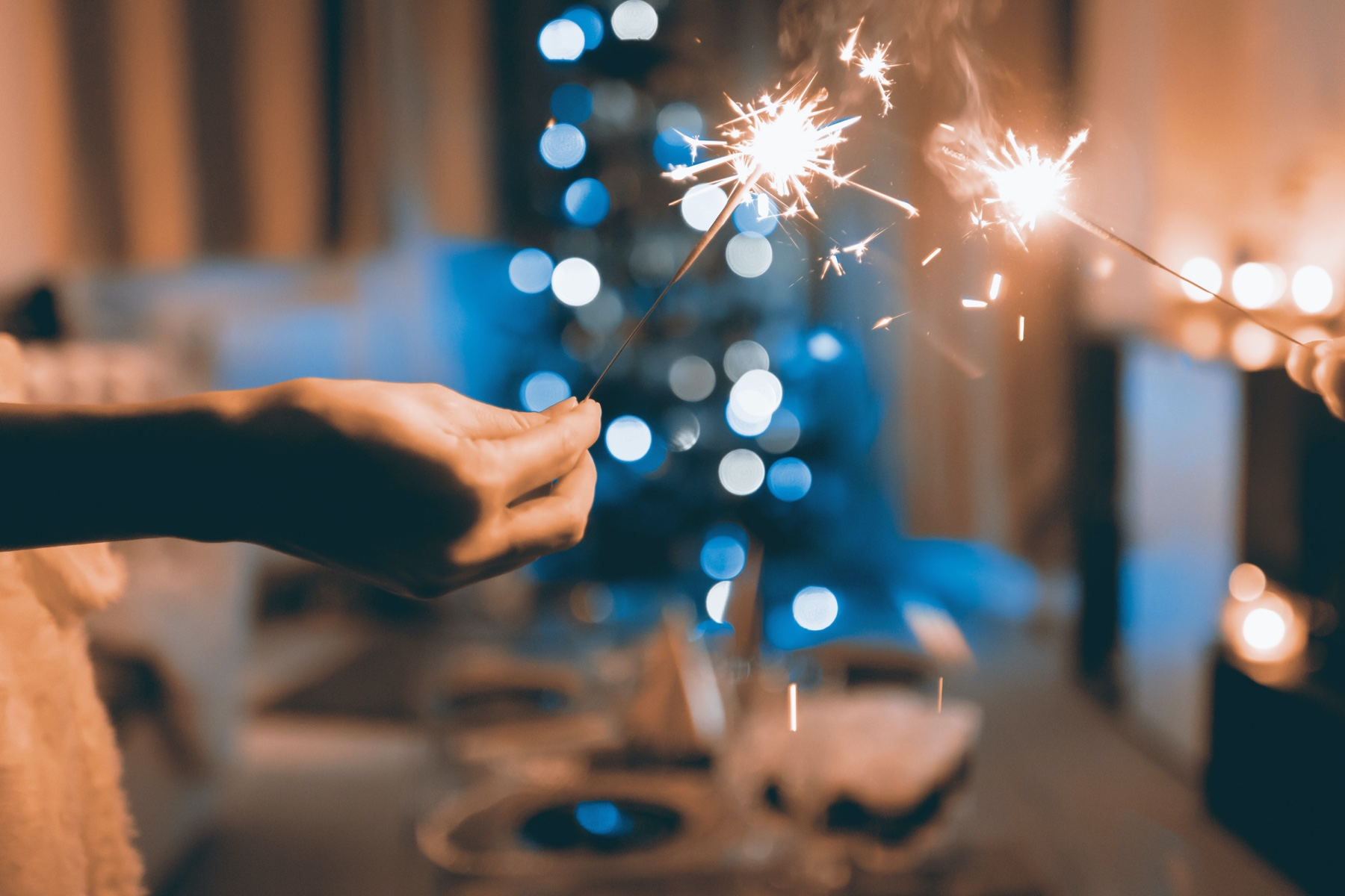 Close up of hands holding sparklers