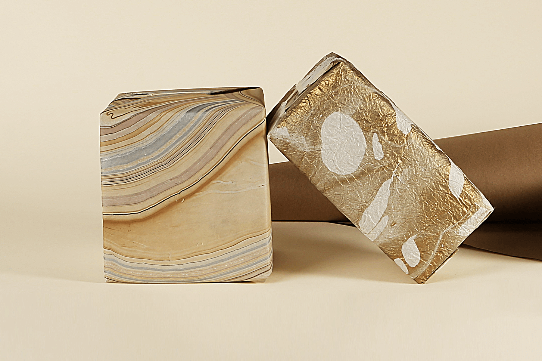 Stack of eco-friendly wrapped gifts on a beige background