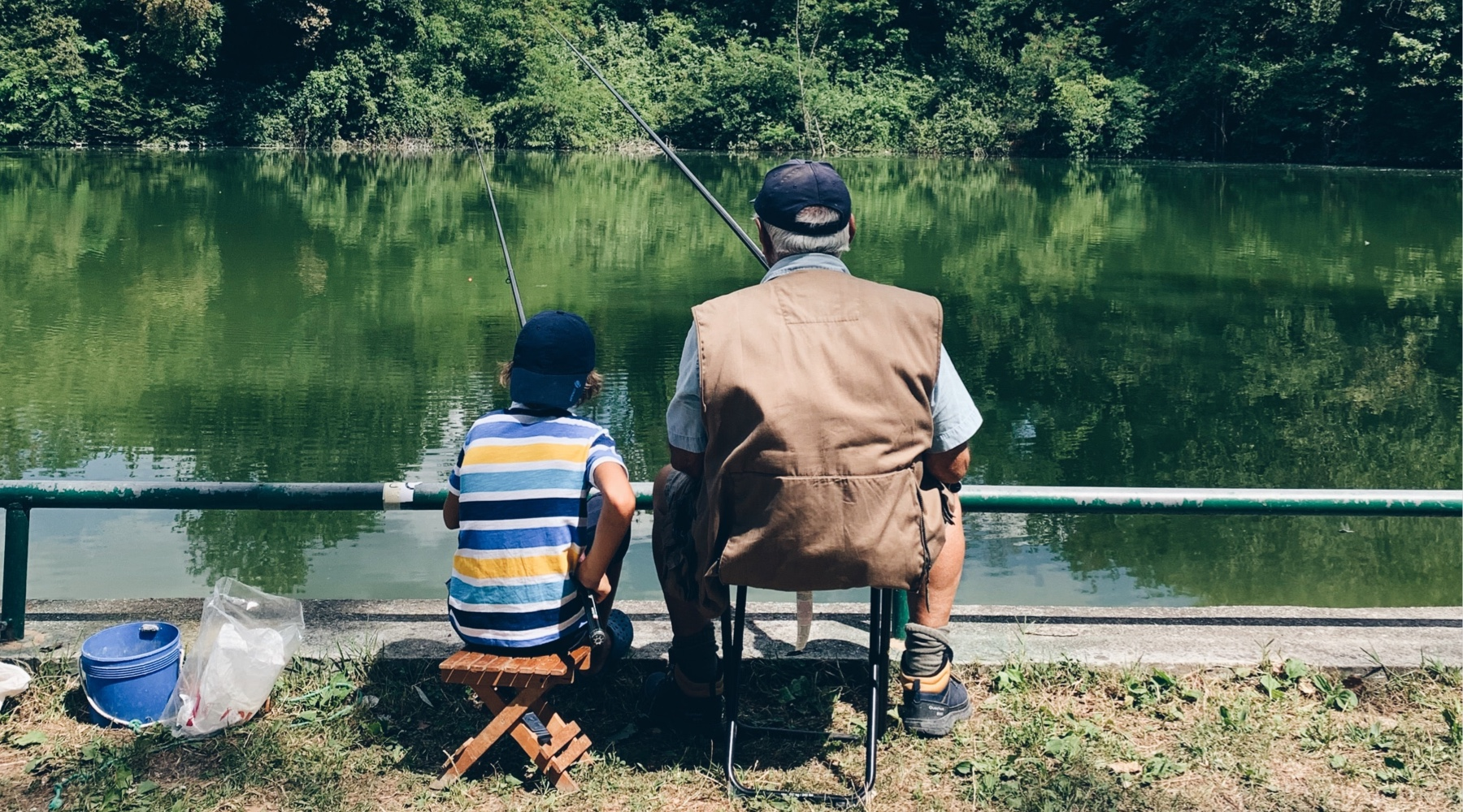 Father and son fishing in chairs