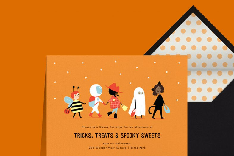 """""""Afternoon Parade"""" invitation by Paperless Post. The orange card features an illustration of five costumed children walking in a line. The card appears on an orange background."""