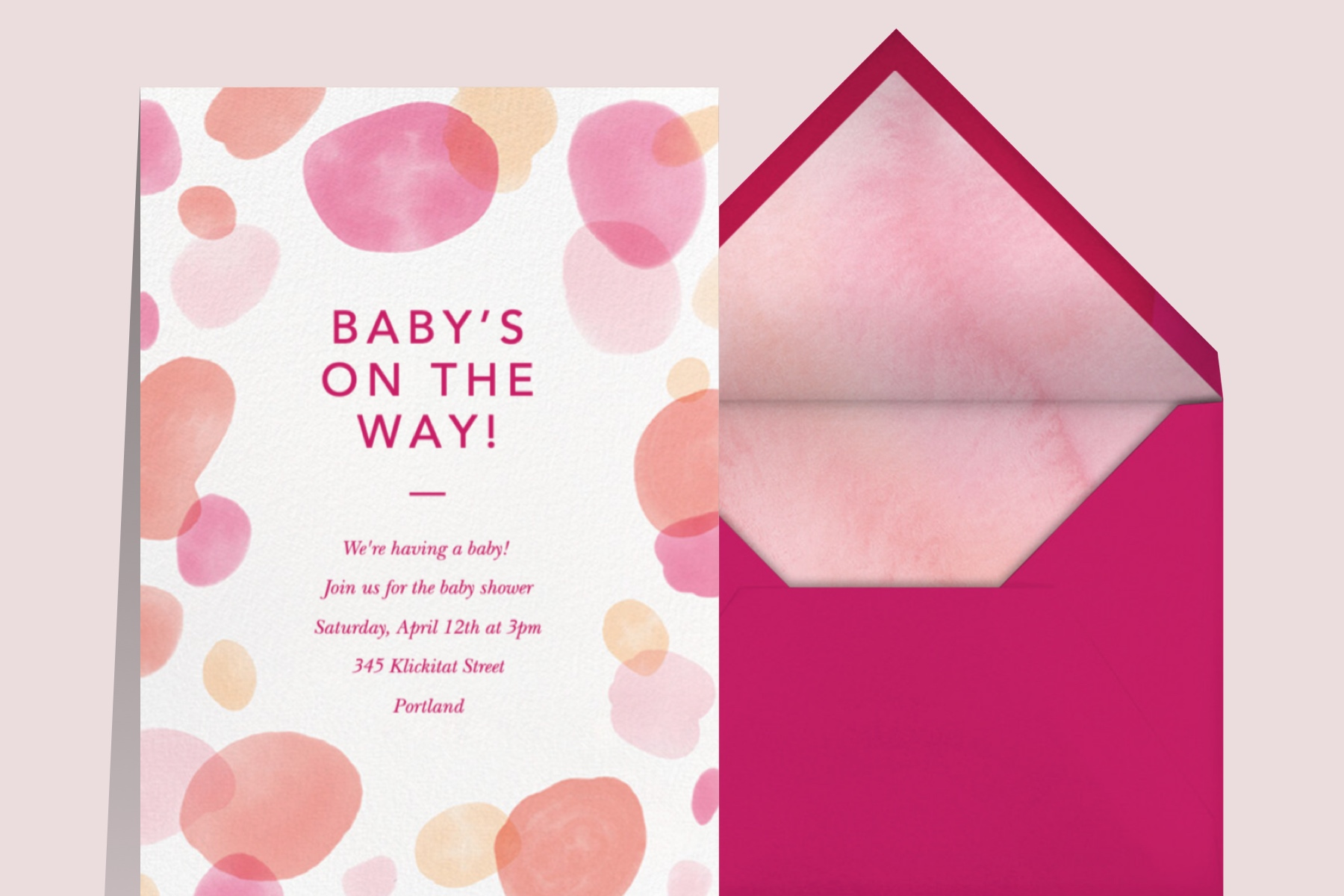 planning your own baby shower with a pink watercolor invitation