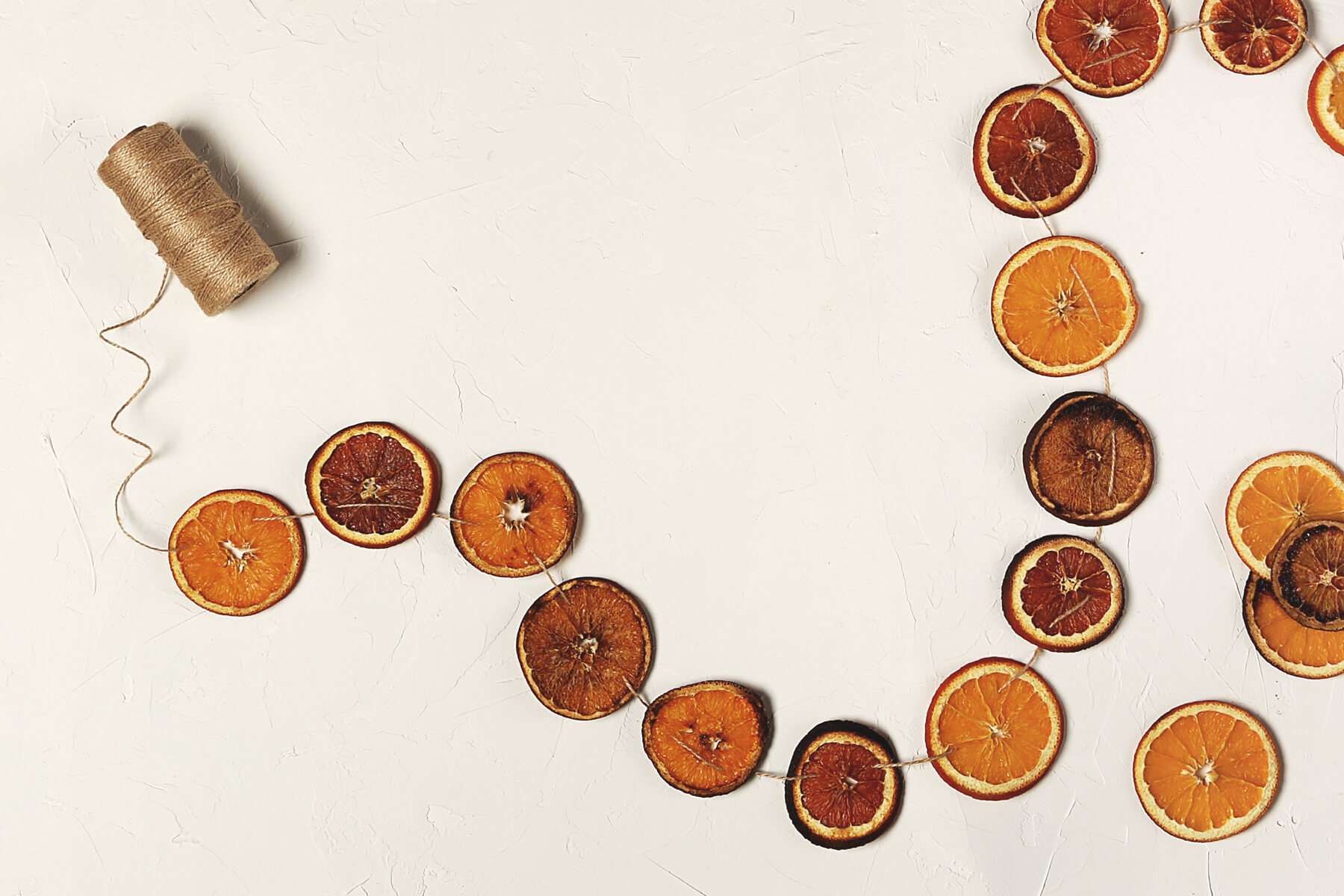 A citrus garland made of oranges and blood oranges.